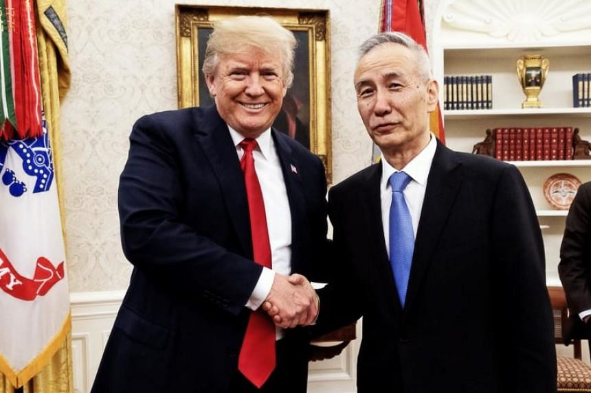 US President Donald Trump with China's vice-premier Liu He. China and the US agreed to abandon any trade war and back off from threatened tariffs.
