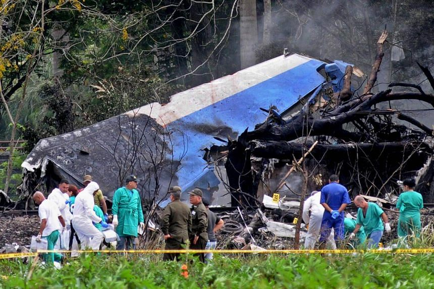 Police and military personnel work among the wreckage of the Boeing-737 plane that crashed shortly after taking off from the Jose Marti airport in Havana, Cuba, on May 18, 2018.