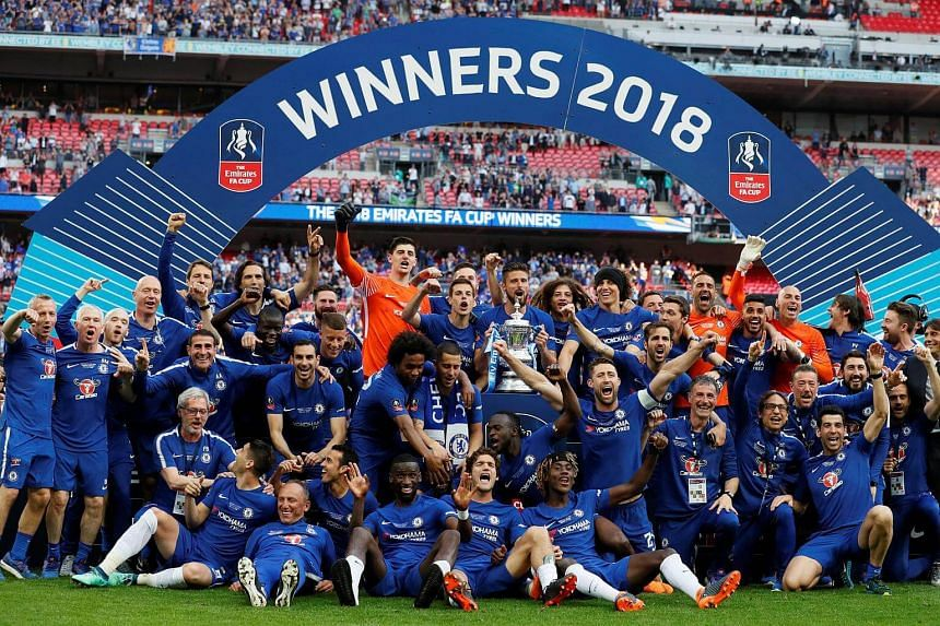 Chelsea players celebrate with the trophy after their victory in the English FA Cup final on May 19, 2018.