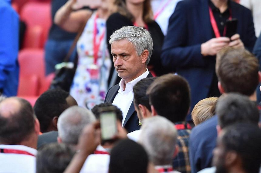 Manchester United's manager Jose Mourinho reacts after receiving his runners up medal on May 19, 2018.