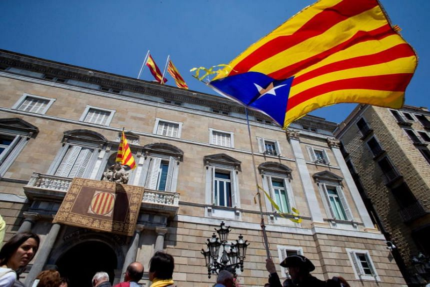 The unofficial Catalan flag Estelada flies at Sant Jaume square during the investiture of the new Catalan regional President, Quim Torra, in Barcelona, Spain, on May 17, 2018.