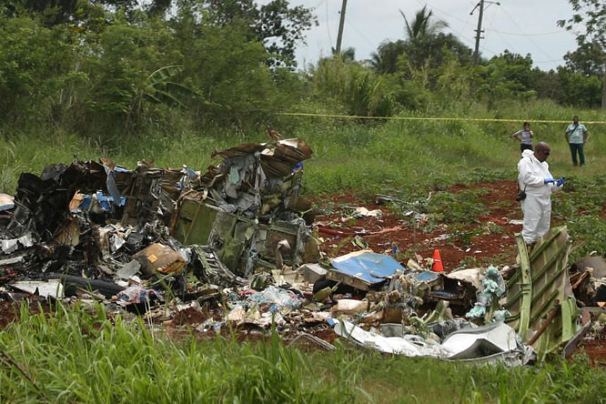 A rescue team member works at the wreckage of the Boeing 737 plane in Cuba, on May 18, 2018.
