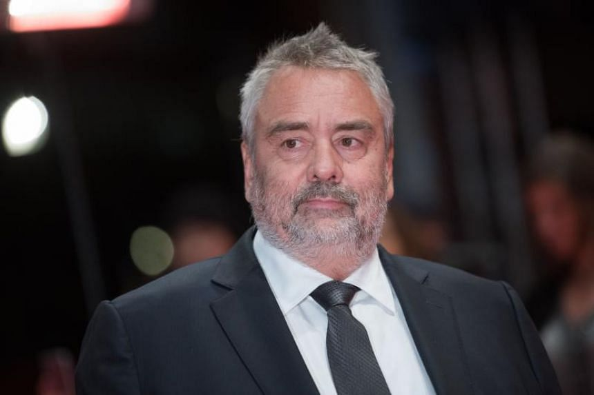 French director Luc Besson poses on the red carpet upon arrival for the premiere of the film Eva presented in competition during the 68th Berlinale film festival in Berlin.