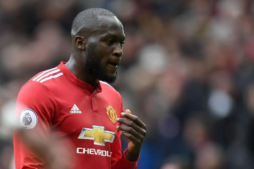 Manchester United's Belgian striker Romelu Lukaku gestures as he leaves the field at half time during the English Premier League football match between Manchester United and Arsenal at Old Trafford in Manchester, north west England, on April 29, 2018