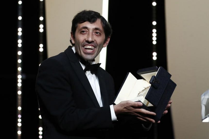 Marcello Fonte accepts his award for Best Actor for the movie Dogman during the Closing Awards Ceremony of the 71st Cannes Film Festival, in Cannes, France, on May 19, 2018.