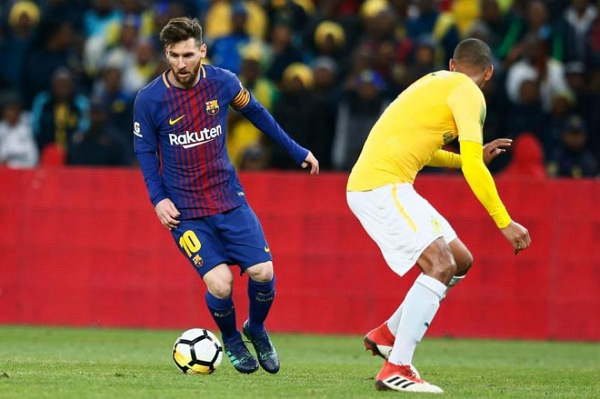 FC Barcelona Lionel Messi (left) plays the ball during a friendly match for the Mandela Centenary Trophy on May 16, 2018.