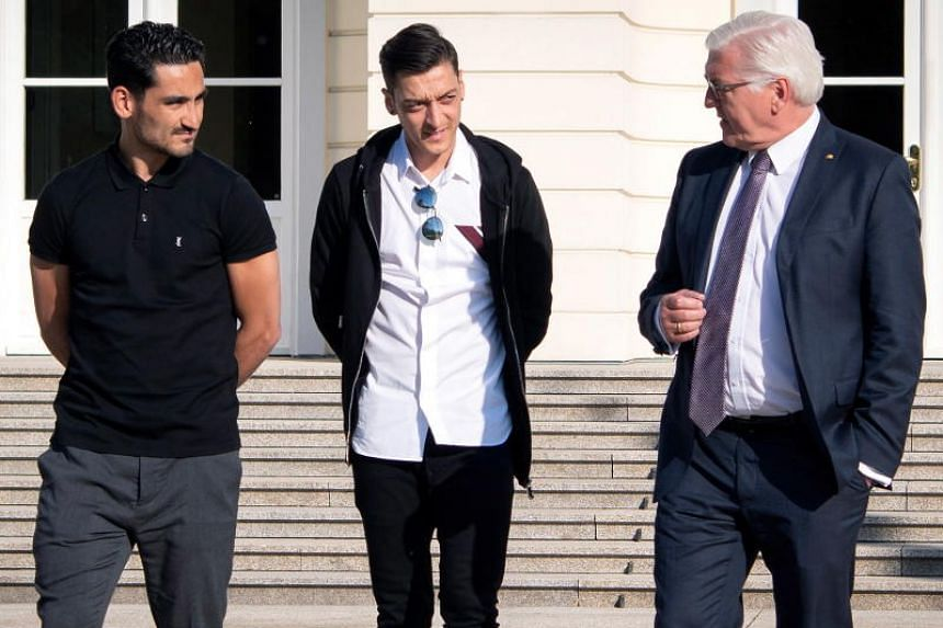 (From left) German national team soccer players Ilkay Guendogan and Mesut Ozil with German President Frank-Walter Steinmeier at Bellevue Castle in Berlin, Germany, on May 19, 2018.