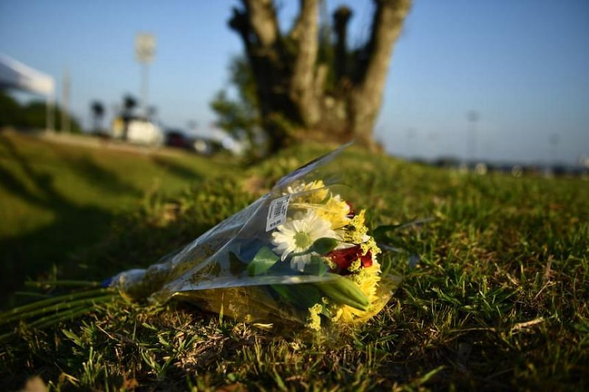 Flowers lie on the ground at Santa Fe High School on May 19, 2018, in Santa Fe, Texas.