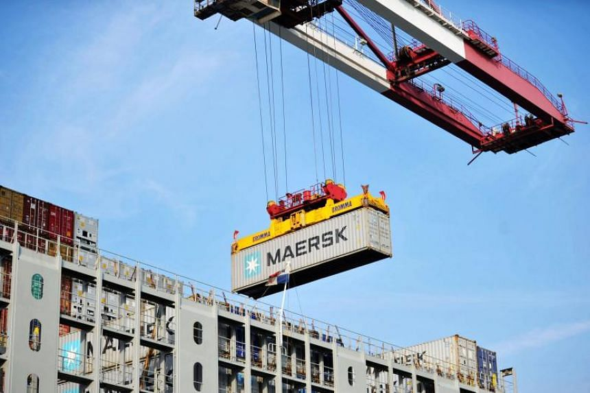 A container is transferred at the port in Qingdao in China's eastern Shandong province on May 8, 2018.