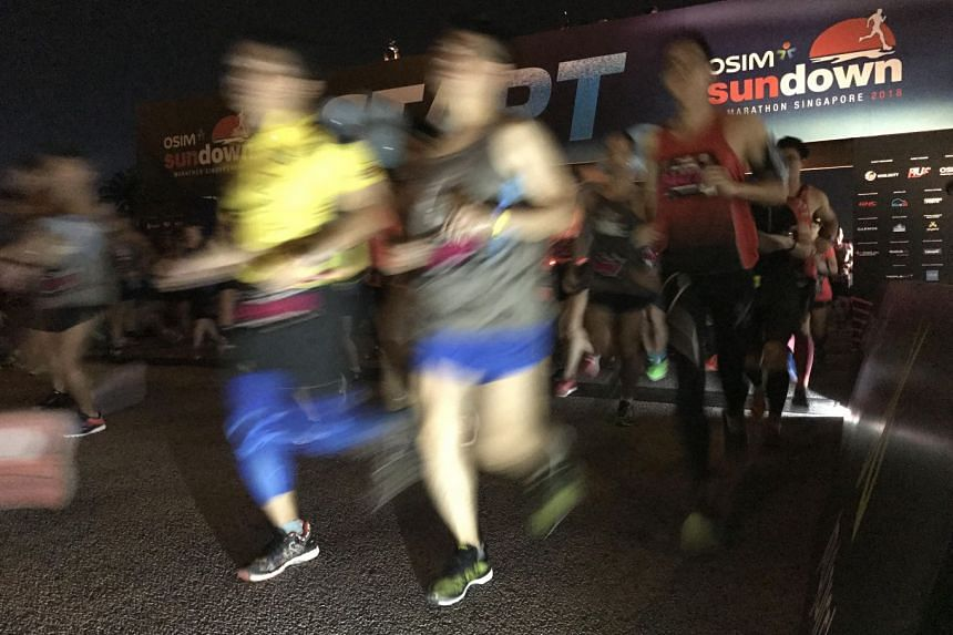 Participants of the 42.195km category at the Osim Sundown Marathon starting their race on May 20, 2018.