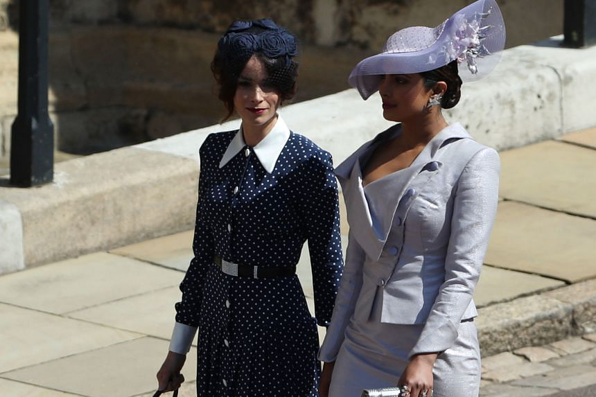 US actress Abigail Spencer (far left) and Bollywood actress Priyanka Chopra adding more glamour to the proceedings, as they joined the wedding's already star-studded guests at Windsor Castle.