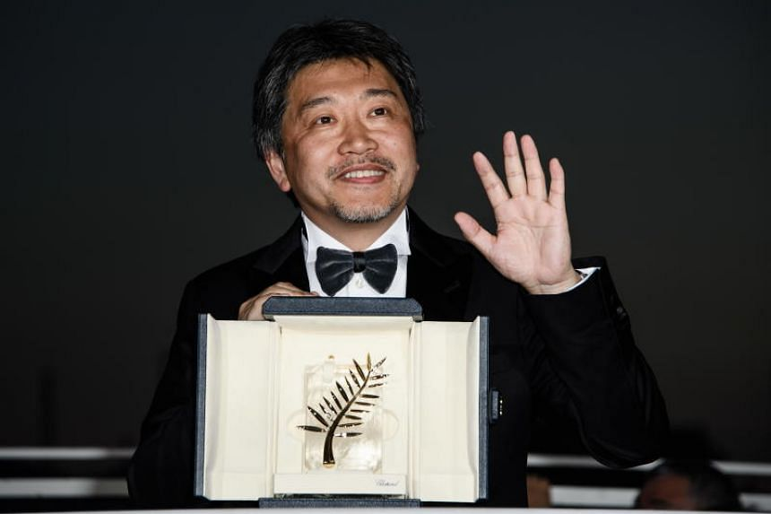 Director Hirokazu Kore-eda posing with his Palm d'Or prize at the Cannes Film Festival on May 19, 2018.