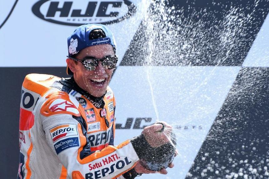 Winner Repsol Honda Team's Spanish rider Marc Marquez celebrates on the podium after the MotoGP race of the French motorcycling Grand Prix on May 20, 2018, in Le Mans, northwestern France.