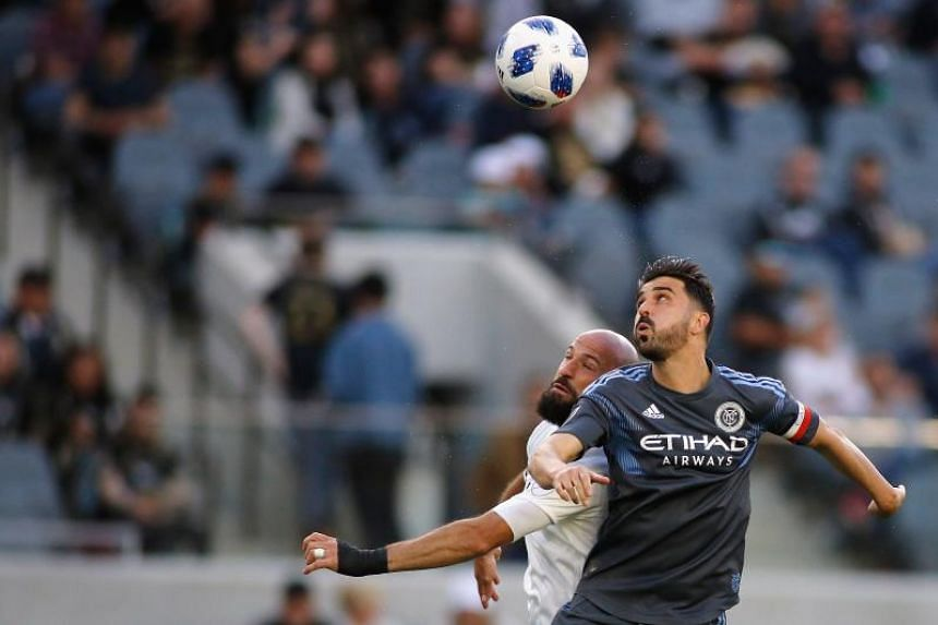 Laurent Ciman of Los Angeles FC (left) and David Villa of New York City FC fight for control of the ball at Banc of California Stadium in Los Angeles, California on May 13, 2018.