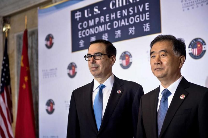 US Treasury Secretary Steven Mnuchin (left) and Chinese Vice Premier Wang Yang at a US and China comprehensive Economic Dialogue at the US Department of the Treasury in Washington, DC on July 19, 2017.