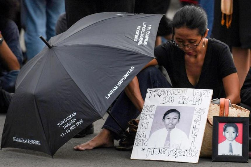 An activist attending a rally demanding justice for those killed during the fall of Indonesia's former dictator Suharto, in Jakarta on May 17, 2018.
