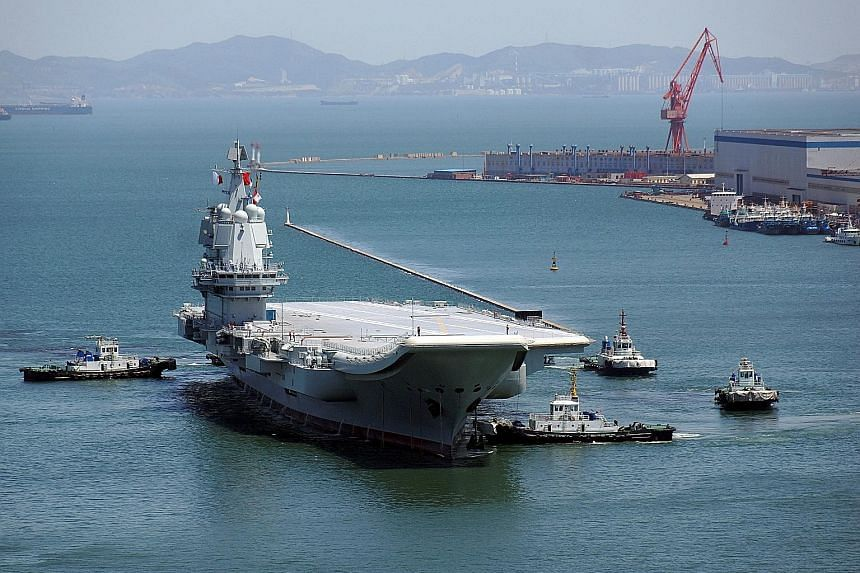 China's first domestically built aircraft carrier completed its debut sea trial last week and returned to a shipyard in Liaoning province's coastal city of Dalian. The People's Liberation Army (PLA) Navy said in a brief statement that the five-day tr