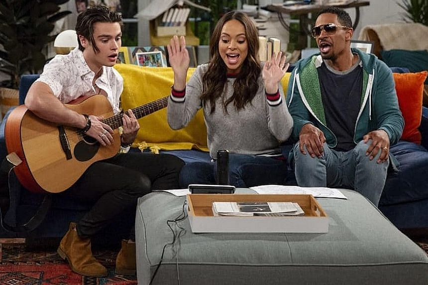 Harry Styles (above) is the executive producer of new TV show Happy Together, which stars (from right) Felix Mallard, Amber Stevens West and Damon Wayans Jr.