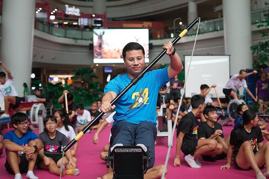 Minister for Social and Family Development Desmond Lee paddling for a good cause yesterday. He was taking part in the 24-hour kayaking challenge organised by Hwa Chong Institution students to raise funds for the Muscular Dystrophy Association, Singap