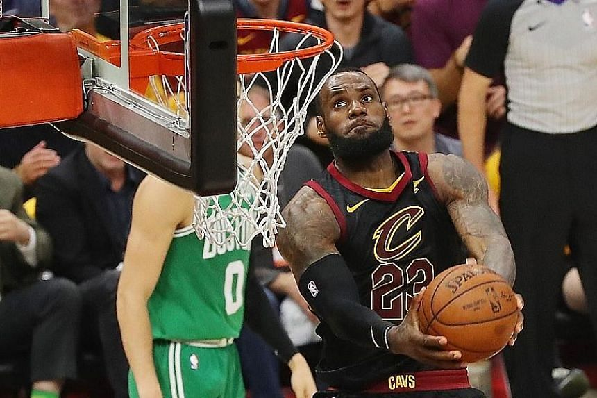 Cleveland Cavaliers star LeBron James on his way to a dunk in the 116-86 win over the Boston Celtics on Saturday.