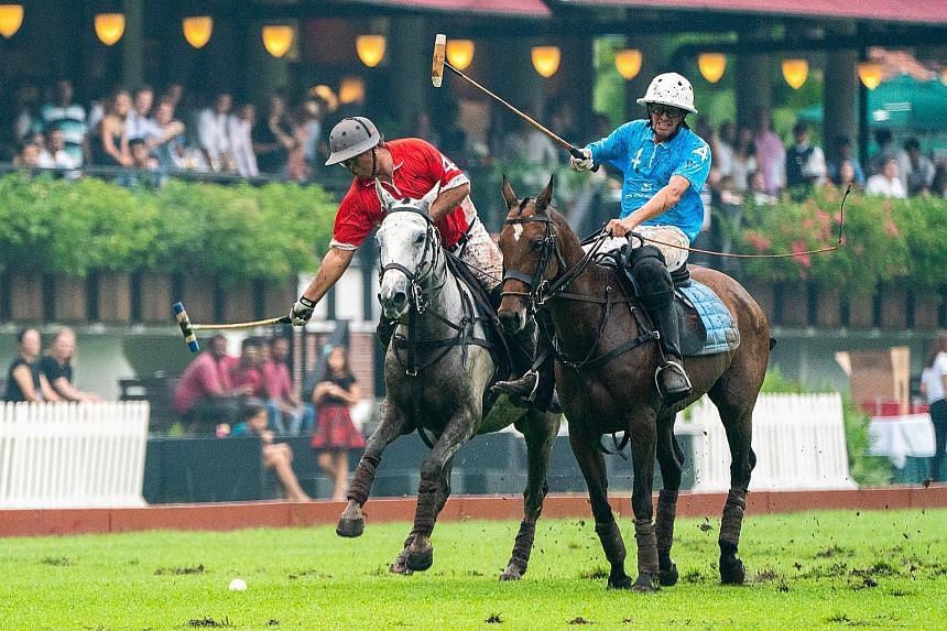Singaporean Sattar Khan (in red), Prudential's team captain, chasing the ball while being challenged by his counterpart from Tata Communications Blue, Argentinian Carlos Pando, during the final of the Singapore Polo Open yesterday. Vinod Kumar put Ta