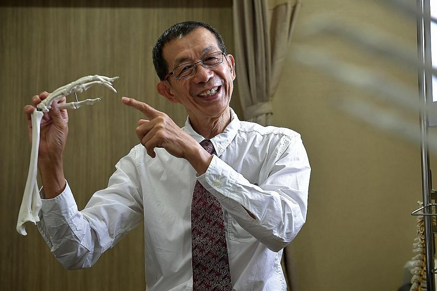 Associate Professor Teoh Lam Chuan's work focuses on restoring the function and appearance of the injured hand.