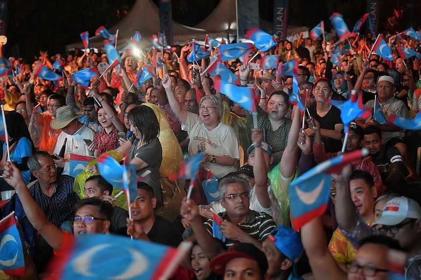 """PKR supporters at a mega rally in Selangor on May 6, before the polls. Datuk Seri Anwar Ibrahim said he had told Prime Minister Mahathir Mohamad that """"we are dealing with a new generation, a new environment""""."""