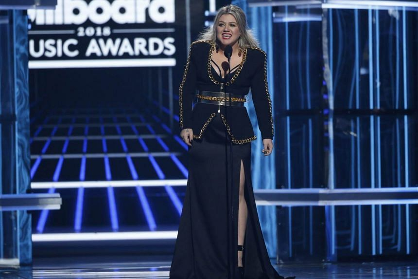 Singer Kelly Clarkson speaks on stage, at the 2018 Billboard Music Awards, on May 21, 2018.