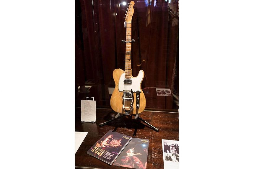 A Bob Dylan/Robbie Robertson 1965 Fender Telecaster guitar is displayed along with other items during a media preview in New York, on May 14, 2018.