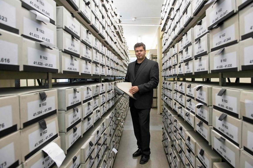 German prosecutor Jens Rommel stands in an archives room in Ludwigsburg, southwestern Germany, on April 19, 2018.