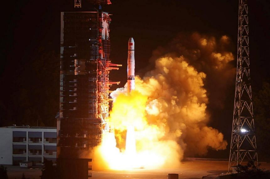 A Long March-4C rocket lifts off from the southwestern Xichang launch centre carrying the Queqiao on May 21, 2018.