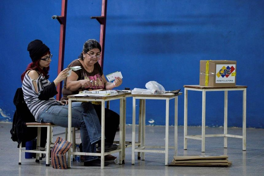 Two women seen at a polling station in Venezuela on May 20, 2018, during an election ignored by much of the country.