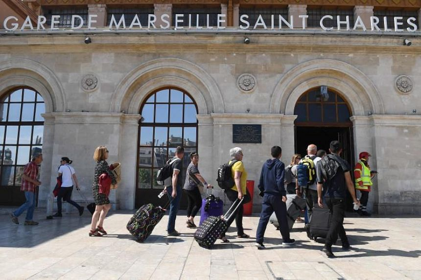 People enter the Gare Saint Charles train station in Marseille on May 19, 2018 after it was briefly evacuated.