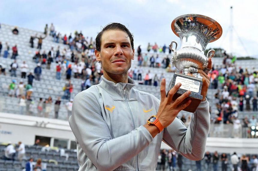 Rafael Nadal of Spain poses with the trophy after defeating Alexander Zverev of Germany (not pictured) in their men's singles final match at the Italian Open tennis tournament in Rome, Italy, on May 20, 2018.
