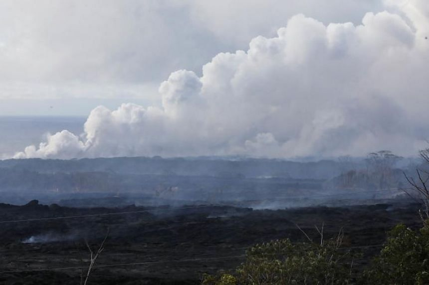 A steam plume rises from lava entering the Pacific Ocean, after flowing to the water from a Kilauea volcano fissure, on Hawaii's Big Island on May 20, 2018 in Kapoho, Hawaii.