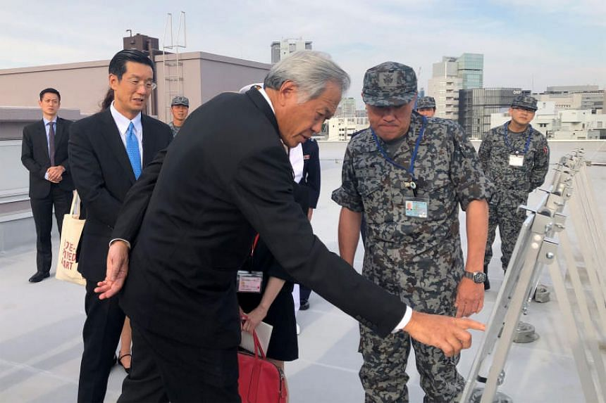 Dr Ng Eng Hen receiving a brief on the Patriot Advanced Capability-3 Interceptor Missile Battery systems at the Japan Ministry of Defence.