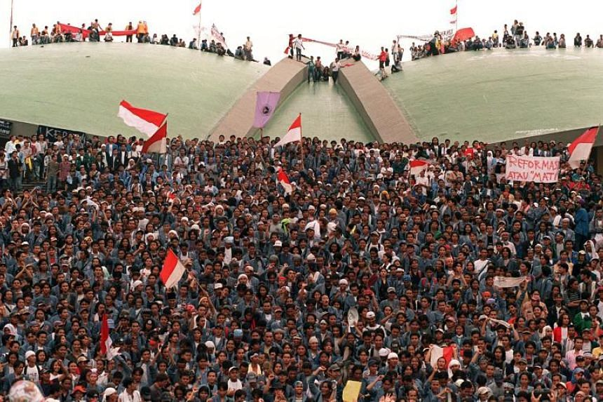 A file photo taken on May 20, 1998, shows Indonesian students gathering in front and on top of the Split Dome of the Assembly Hall of Parliament in Jakarta.