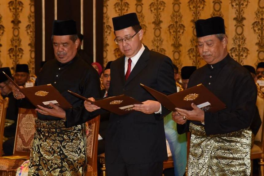 (From left) Mr Mohamad Sabu, Mr Lim Guan Eng, Mr Muhyiddin Yassin being sworn in as Defence Minister, Finance Minister and Home Minister respectively.