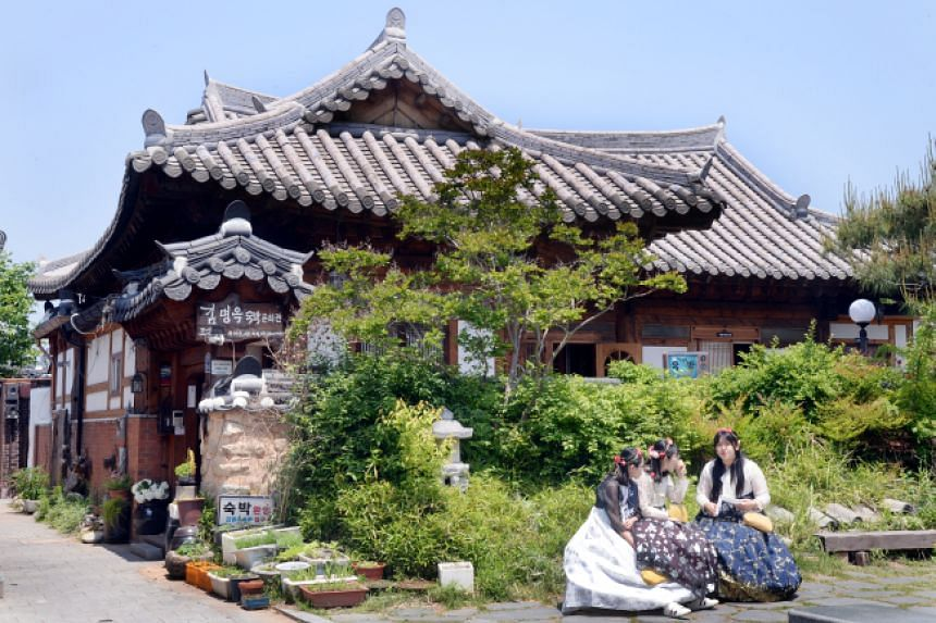 The village is always bristling with tourists, many dressed in modernised hanbok.