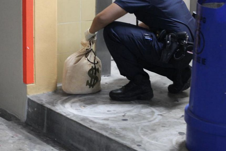 The bag was in a stairwell at Block 297 Compassvale Street.