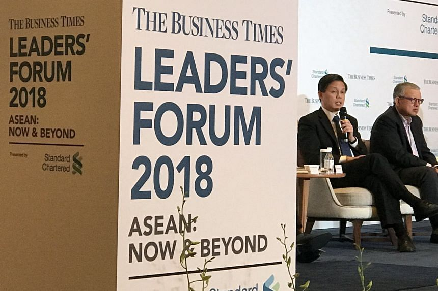Minister for Trade and Industry Chan Chun Sing (left) and CEO of the Singapore Business Federation (SBF), Mr Ho Meng Kit, at The Business Times' Leaders Forum, on May 21, 2018.