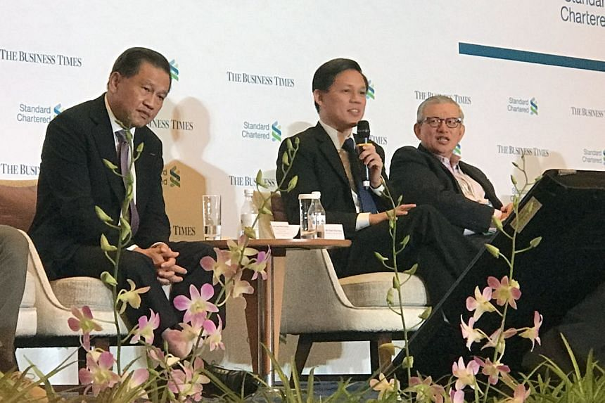 Chairman of Surbana Jurong and Changi Airport Group, Mr Liew Mun Leong (left), Minister for Trade and Industry Chan Chun Sing (centre) and CEO of the Singapore Business Federation (SBF), Mr Ho Meng Kit, at The Business Times' Leaders Forum, on May 21