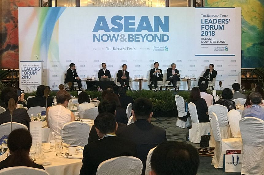 The panel at The Business Times' Leaders Forum: (From left) Moderator, Deputy News Editor of The Business Times, Mr Lee U-Wen; CEO of Lazada Singapore, Mr Alexis Lanternier; Chairman of Surbana Jurong and Changi Airport Group, Mr Liew Mun Leong; Mini