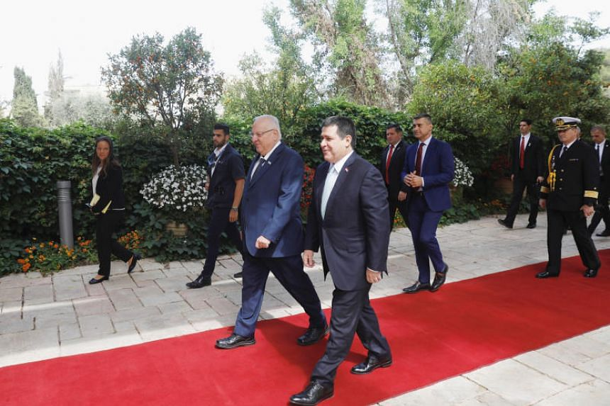 Paraguayan President Horacio Cartes (right) arrives at Israeli President Reuven Rivlin's (left) residence in Jerusalem on May 21, 2018.