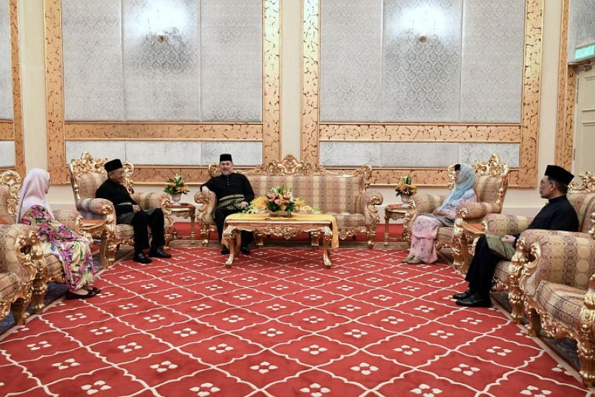 (From left) Malaysia's Deputy Prime Minister and Minister of Women and Family Development Wan Azizah Wan Ismail, Prime Minister Mahathir Mohamad, King Sultan Muhammad V, Tun Dr Mahathir's wife Dr Siti Hasmah and premier-in-waiting Anwar Ibrahim at th