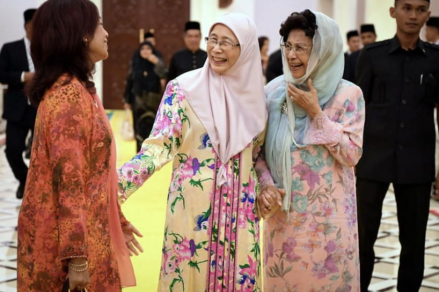 Malaysia's Deputy Prime Minister and Minister of Women and Family Development Wan Azizah Wan Ismail and Dr Siti Hasmah, wife of Prime Minister Mahathir Mohamad, being greeted at the royal palace.