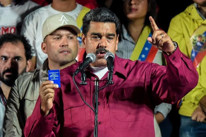 """Venezuela's socialist President Nicolas Maduro hailed his win as a victory against """"imperialism,"""" but his main rival alleged irregularities and refused to recognise the result."""