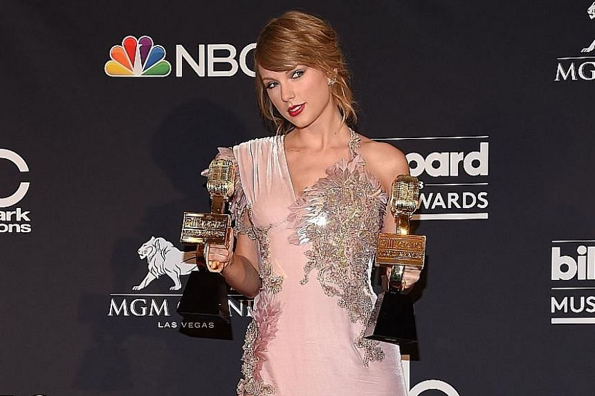 Singer Taylor Swift (above), making her first appearance at an awards show in two years, won Top Female Artist and Top Selling Album for Reputation.