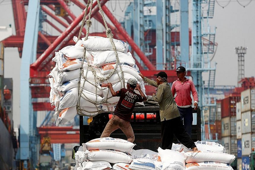Workers unloading bags of rice at Tanjung Priok port in Jakarta. Indonesia is the top choice for businesses looking to expand into Asean as it accounts for about 40 per cent of Asean's gross domestic product and has strong growth potential, said econ