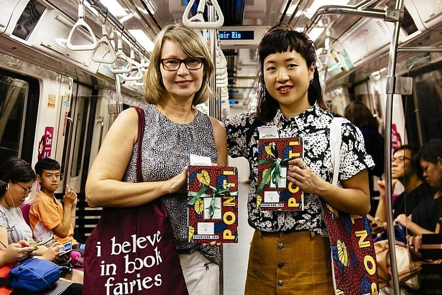 Housewife Petra Sander from Book Fairies Singapore and author Sharlene Teo (above) recently left books around Singapore for members of the public to discover, including beside the sculpture Man On The Bench in front of Capitol Tower.